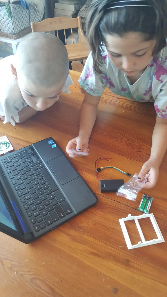 Discovering electrical circuits with an LED light kit.