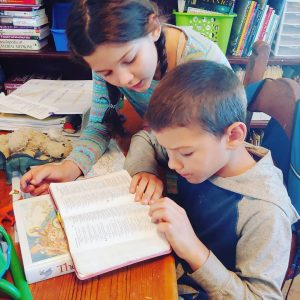 An older sibling can help youngers with their school work. This is great for both kids!